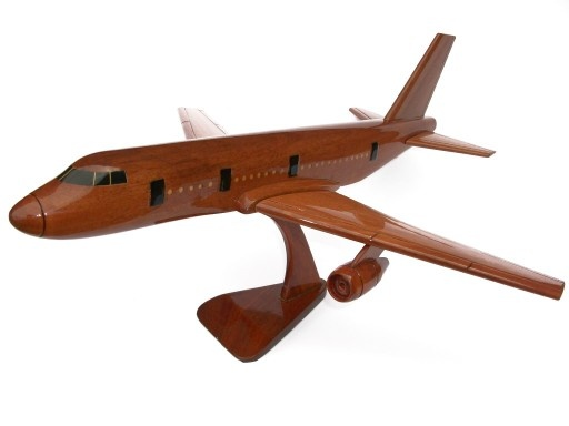 """A beautiful hand carved desktop model of the Boeing 767. The model has been carved from solid mahogany. The model comes boxed and is simple to assemble. The wings, tail fins and stand simply slot into pre-drilled holes on the body of the aircraft. No glue required. Size H 10"""", L 15"""", W 17"""". Visit our website at thewoodenmodelcompany.co.uk to view the full range of our models."""