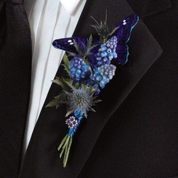 Butterfly boutonniere for the guys.  Keywords: #butterflyweddings #jevelweddingplanning Follow Us: www.jevelweddingplanning.com  www.facebook.com/jevelweddingplanning/