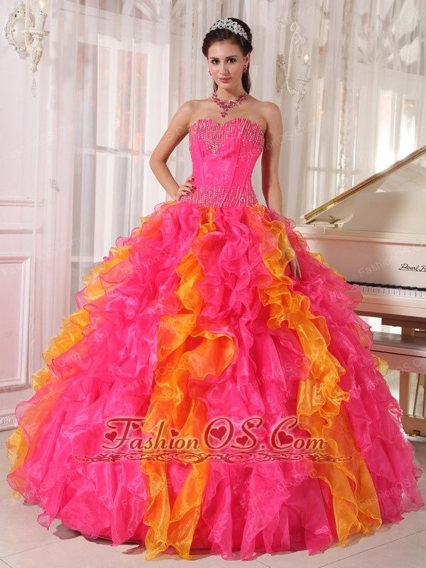 Beauty Hot Pink and Orange Quinceanera Dress Sweetheart Organza Sequins Ball Gown  http://www.fashionos.com  http://www.youtube.com/user/fashionoscom?feature=mhee   The splendide quinceanera dress features a sweetheart neckline with colorful crystals covered the bustline and waistline, which highlighted your slim figure.Tiers of fullles in contrasting colors makes the skirt stand out.You'er surely be the nightspot at your party in the dress.