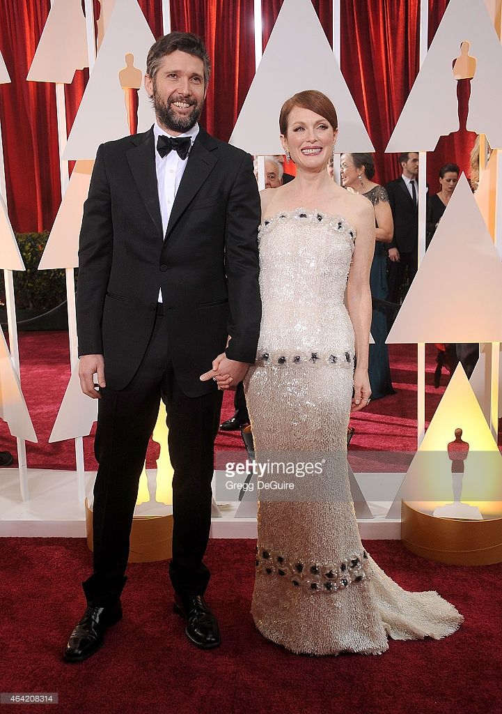 Actress Julianne Moore and husband Bart Freundlich arrive at the 87th Annual Academy Awards at Hollywood & Highland Center on February 22, 2015 in Hollywood, California.