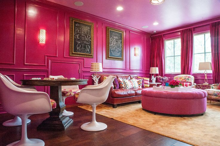 Gotta love the pink family room (even the ceiling) with white tulip chairs!  Jenny Tamplin Interiors