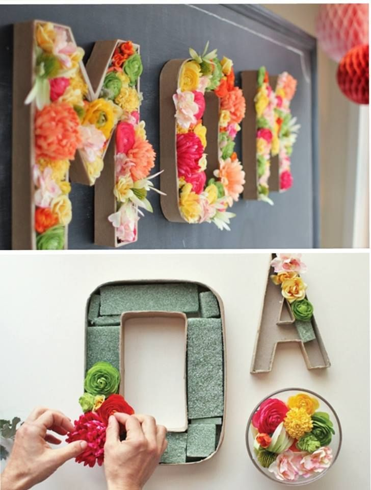 I like the fake flowers filling these letters, too -- another fun way to spice up a room for not-too-expensive (if you shop the sale flowers)