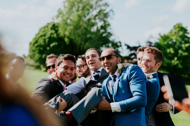 Lads just love picking each other up! Photo by Benjamin Stuart Photography #weddingphotography #groom #groomsmen #lads #squad #grouphoto