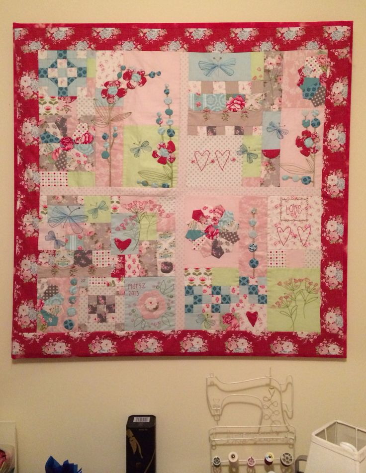 Mounted wall patchwork quilt with hand sewn details. Absolutely beautiful!!