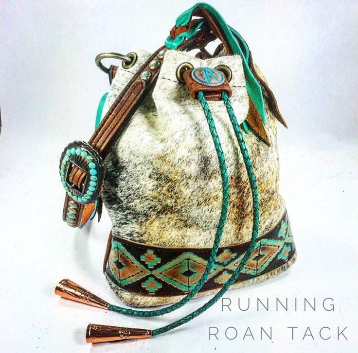 """""""The Bolo"""" Light Brindle Cowhide Cross Body Bucket Bag with Aztec Print, Jingle Cones and Braided Leather Drawstring by Running Roan Tack"""