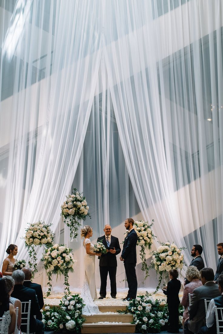 A beautiful wedding in the Jack Singer Concert Hall lobby at Arts Commons. Credit: Abby plus Dave Photography