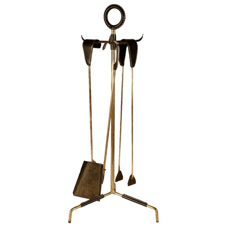 1950s Jacques Adnet Fireplace Tools   From a unique collection of antique and modern fireplace tools and chimney pots at https://www.1stdibs.com/furniture/building-garden/fireplace-tools-chimney-pots/
