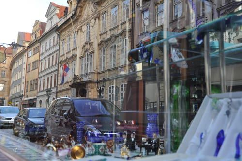 sometimes I just love the reflection of the real world in the shop window that first attracted me by its Visual Merchandising - Prague 2010