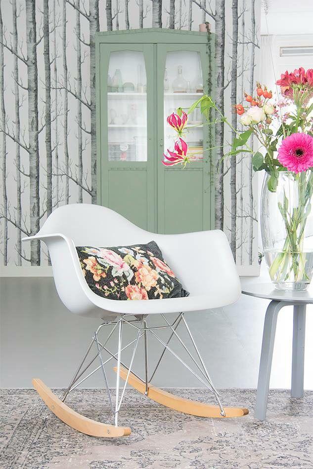 Love it all - the Eames RAR rocker, the cushion, the rug, the wallpaper, the flowers.  Scrumptious.