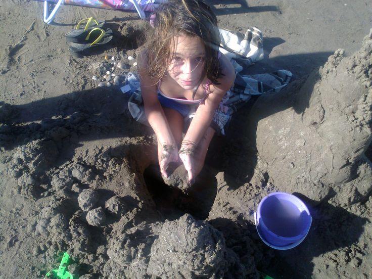 Milena en la playa.