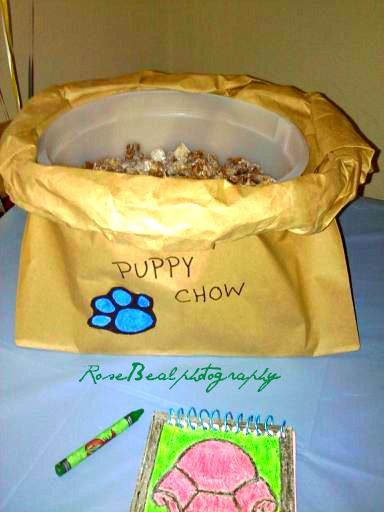 "We decided for my daughters 'Blues Clues' themed party to make some buddy muddy chex mix...(recipe on back of chex box) also known as puppy chow. So to go along with party we took a brown grocery bag and just rolled down the sides to make it look like an opened bag of ""puppy chow"" It was a hit! My sis also made the handy dandy notebook. With large post it sheets & some wire. And hand drew the outside picture. Cost about $5 but if you were to buy it online it would cost $12-$20 I like the $5…"
