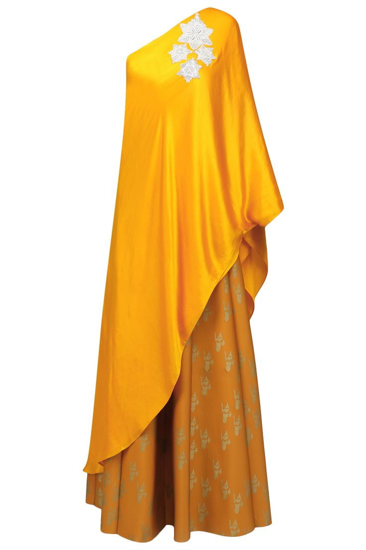 Mustard yellow one shoulder cape and floral skirt set available only at Pernia's Pop Up Shop.