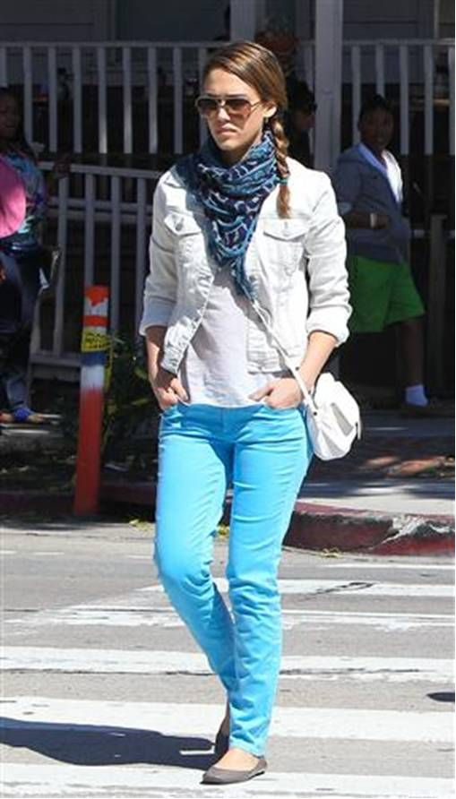 white denim jacket with colored jeans and casual hair and infinity scarf