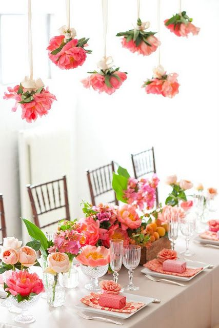 """This idea not only creates a wonderful table scape of coral charm peonies and garden roses but it also creates a beautiful """"chandelier"""" of peonies tied together in small bouquets."""