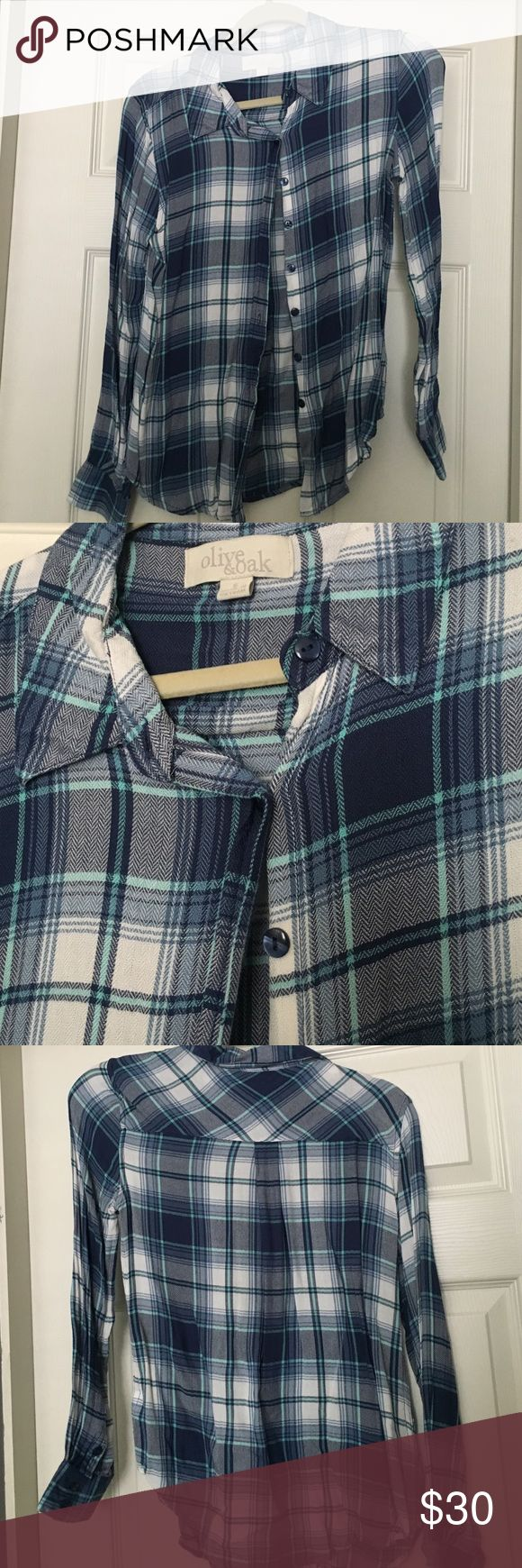Blue plaid button up Pretty blue plaid blouse made of a breathable fabric and not flannel. More feminine fit than some typical plaid shirts. Olive & Oak Tops Button Down Shirts