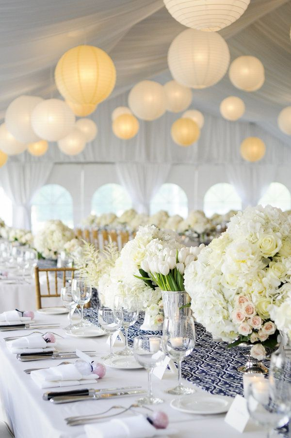 White flowers of various textures with hanging paper lanterns give this look a simple but elegant style.