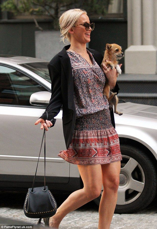 She also has a cat nicknamed Chaz Bono: The 25-year-old Oscar winner showcased her Pilates-toned legs in a boho-patterned mini-dress beneath a black blazer, and sensible ballet flats