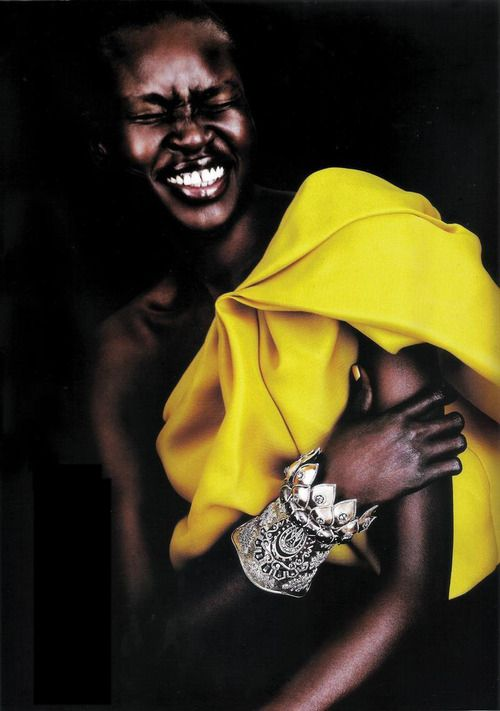 Alek Wek. I think she has the most beautiful smile