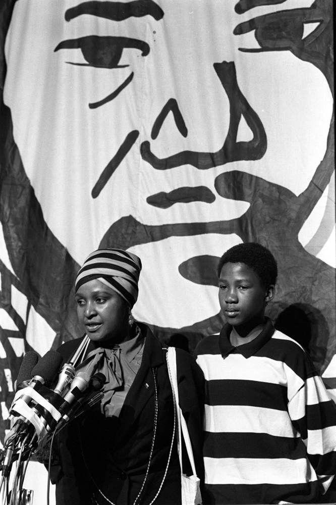 Nelson Mandela 1918-2013. Showing Winnie Mandela with her Grandson