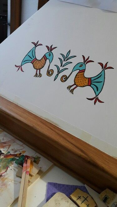 Sardian Birds on a wooden extractor hood for cooking.