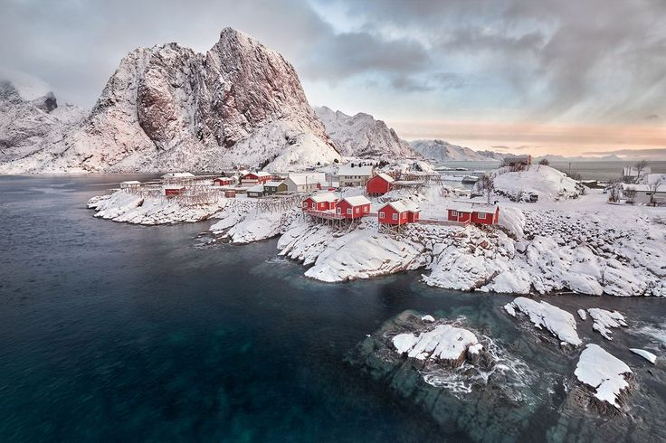 One of the most famous view in Europe, the small town of Hamnoy in the south of the Lofoten Islands.    These tiny red houses, called rorbuer, really made the place so iconic.