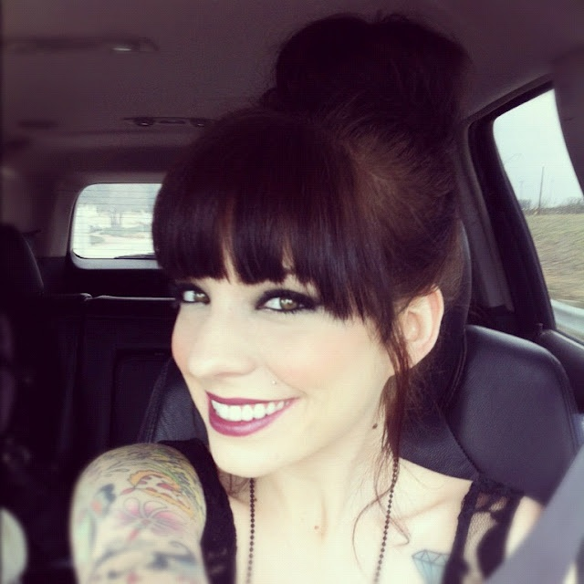 top knots with bangs and dark eyes
