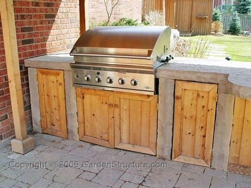 BBQ in outdoor kitchen area.