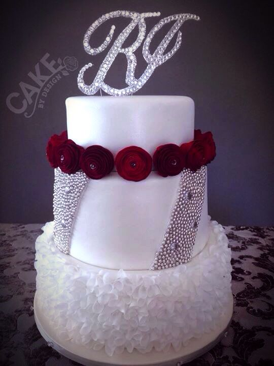 'Old Hollywood' themed wedding cake. Handmade wafer paper 'ruffle' comprising almost 600 separately attached cones. Hand modelled gum paste roses & handmade bling monogram topper.