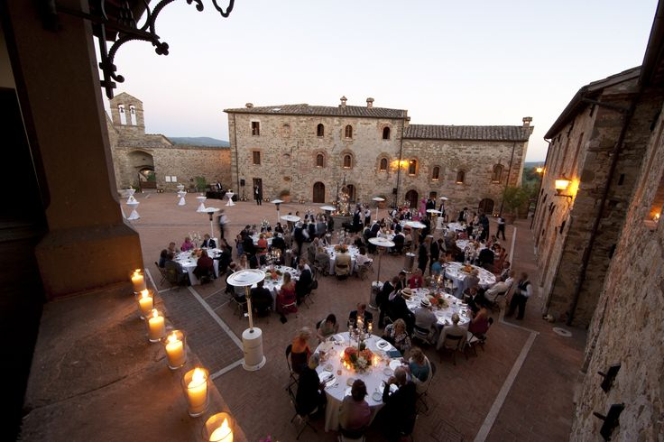 The dinner in a beautiful open air space in the luxury castel in chiantishire
