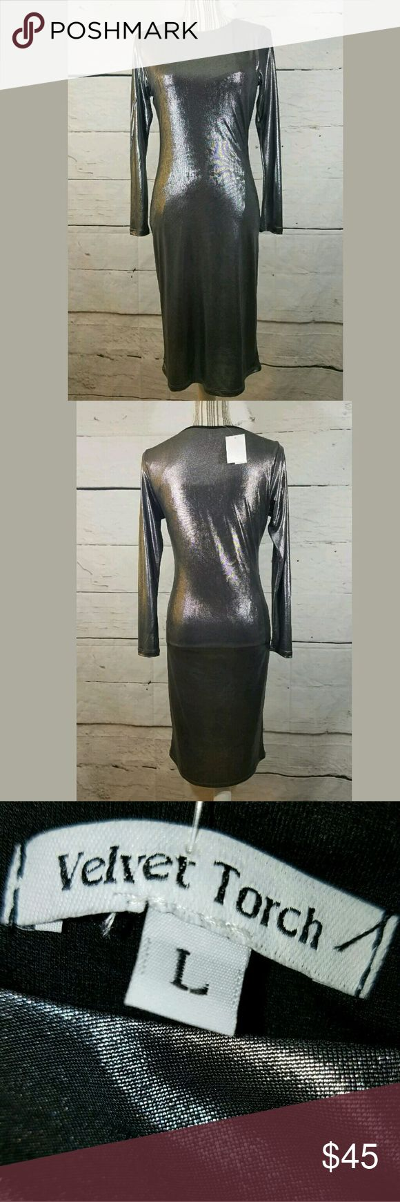 Velvet Touch Metallic Silver Bodycon Stretch Dress Velvet Touch Metallic Silver Bodycon Stretch Dress Large  Gorgeous dress. Fully lined.  17 inches pit to pit.  28 inch waist.  Hips stretch up to 50 inches.  41.5 inches long.    LB Velvet Torch Dresses
