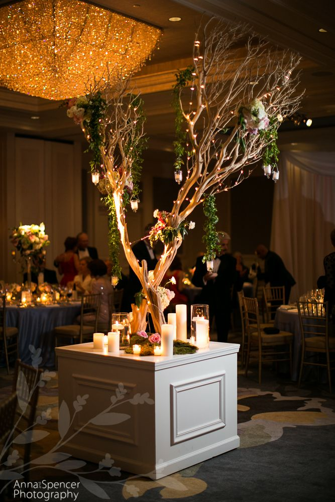 Anna and Spencer Photography, Buckhead Wedding Photographers. The Ritz Carlton Buckhead wedding reception ballroom with large scale tree & floral decor. Flowers by A Legendary Event.