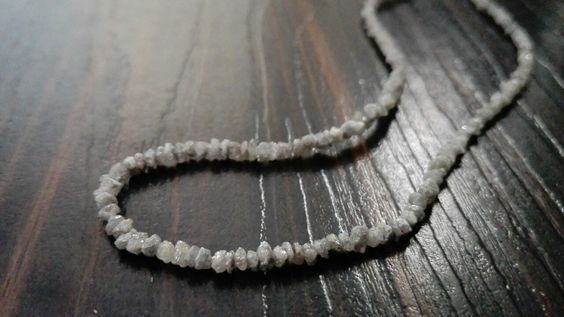 Gray Raw Uncut Diamond Strand Necklace For Sale from Indian manufacturer Gemone Diamonds. Natural gray color rough diamonds drilled beads of size 2 to 3 mm.