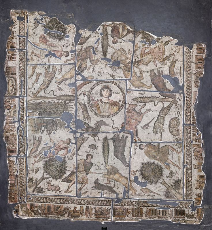 Inventory No : 1016 The Yakto Mosaic consists of three sections. At the heart of the mosaic is a MEGALOPSYCHIA (Great Spirit) figure surrounded by hunters. The outer border depicts daily life and architectural texture of Antioch.