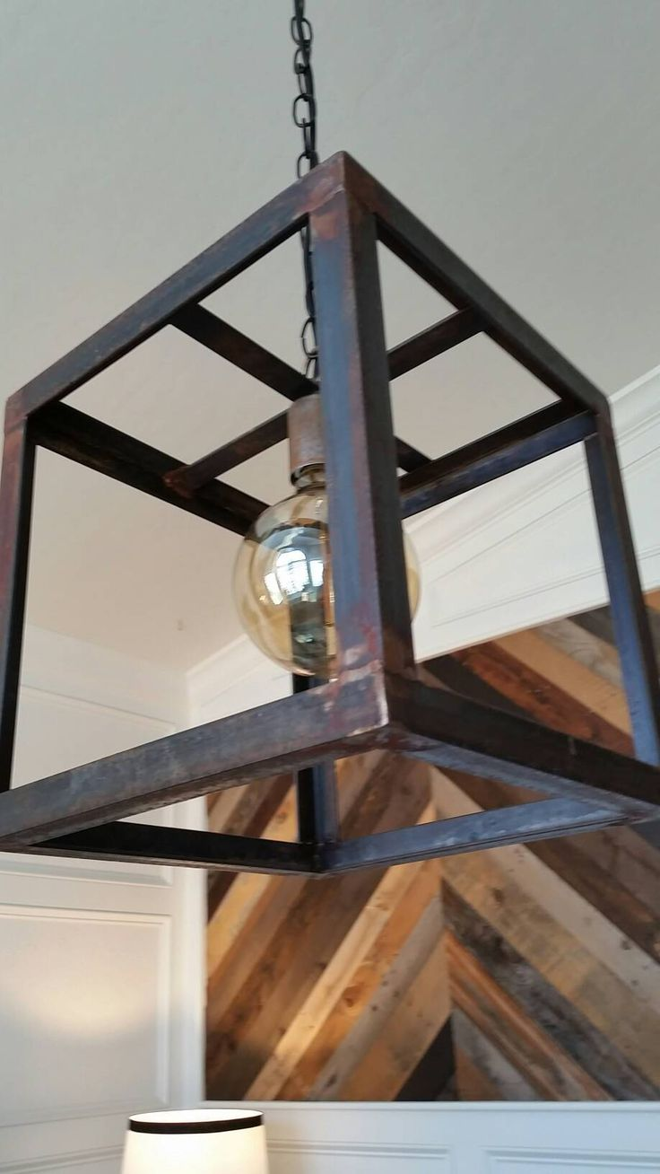 Rustic Steel Cube Pendant with a slight rust patina Custom colors/finishes available. Ceiling canopy and mounting hardware included. Measures 12 x 12 x 12 Free Shipping