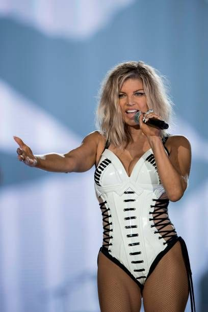 American singer Fergie performs at the Rock in Rio Festival in the Olympic Park, Rio de Janeiro, Brazil, on September 16, 2017. Running for seven days in all -- Friday through Sunday and then September 21 to 24 -- Rock in Rio is being welcomed by the city as a chance to put the huge facilities built for the 2016 Olympic Games back in use. Rock in Rio is one of the world's biggest music events and this year's edition is three times bigger than in previous years. / AFP PHOTO / Mauro PIMENTEL