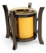 "This Asian lantern style oil warmer measures 6.5"" tall and 6.25"" diameter. Orange cylinder with bronze tinted dish for the oil. Uses one 35 watt halogen bulb (included). You can use either scented oils or tarts in this oil warmer. The 36"" power cord has a built in dial that allows you to adjust the heat and light. Turn it up to use as a lamp, turn it down for use as a night light. Attractive design compliments any style or decor."