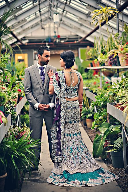bride and groom in greenhouse photoshoot, bride in gorgeous blue lengha with silver embroidery, train lengha