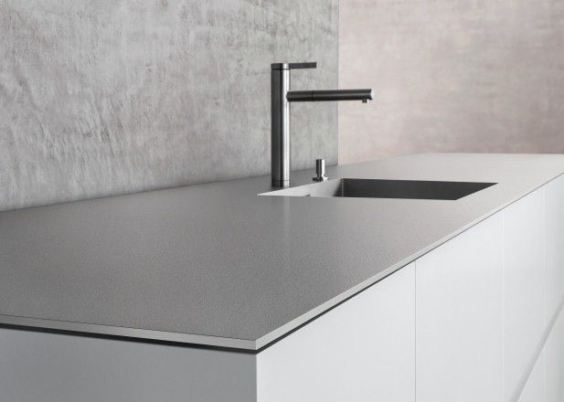 Minimalist kitchen design, doors flush with work surface, 6mm thick stone, undermount sink