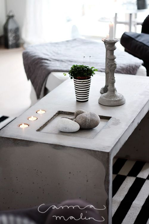 Concrete coffee table. Complete with inbuilt candle and pebble holders..