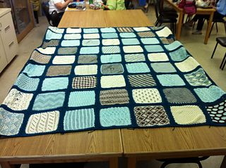 This pattern book teaches knitting stitches and techniques by making individual blocks that are then joined to make an afghan. The pattern requires 28 ounces each of two different light color yarns...