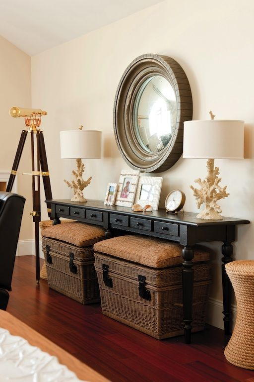 Adding a console table in your Living room, whether its behind a sofa or against a wall, allows for more storage space and can open up the seating area. It also creates a secondary zone that becomes a statement against a blank wall. The baskets underneath the table are very versitile. They can be used as storage and seating.