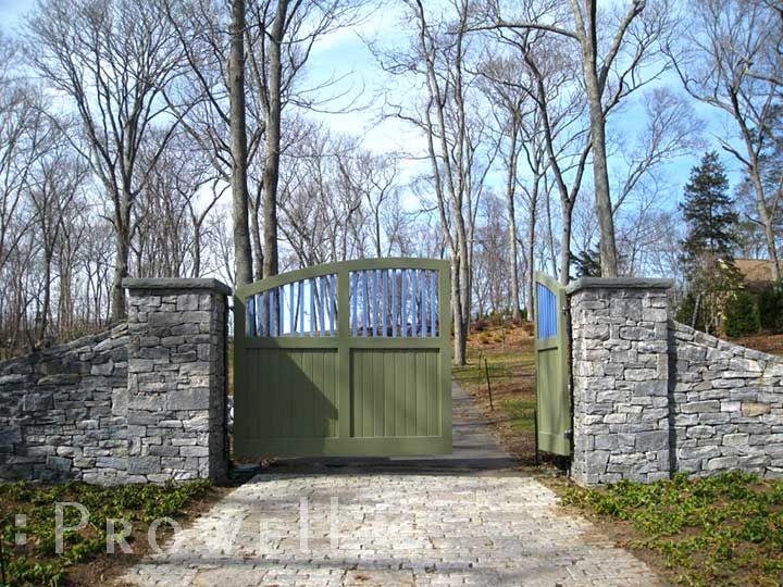 farm driveway entry gate ideas | driveway gates set to stone columns
