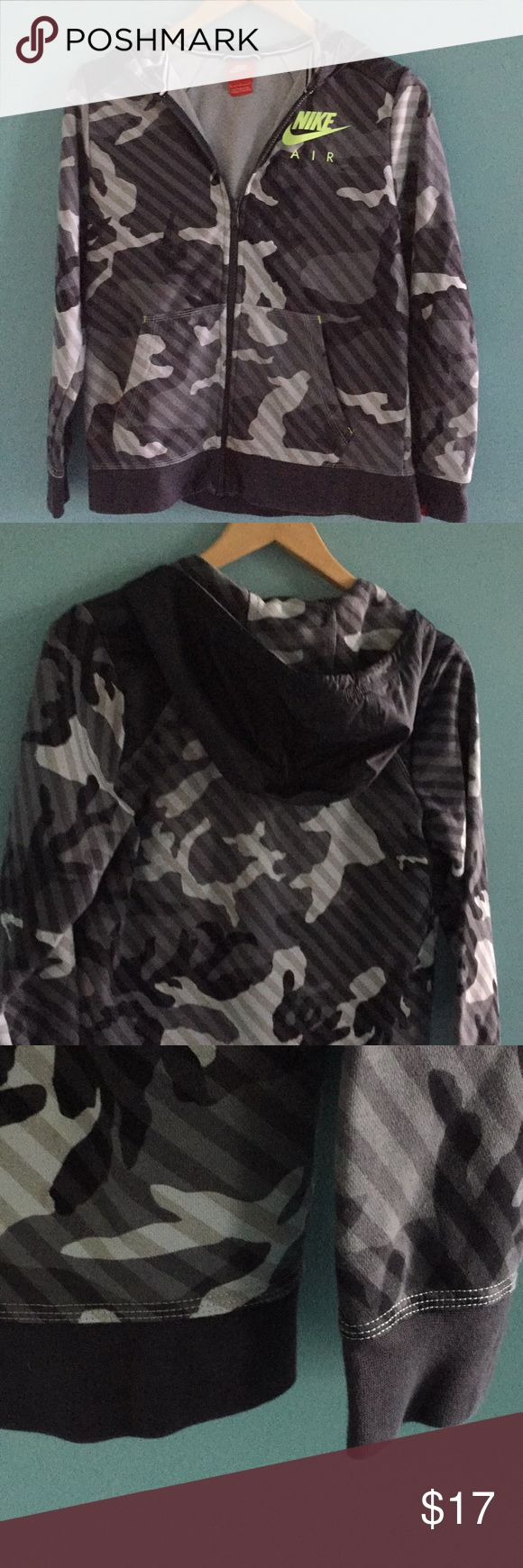 Nike zip hoodie jacket Multi media Zip up hoodie jacket in grey camo pattern. Shoulders and hoodie in water repellent material, rest of the body in sweatshirt material. Fits true to size, hardly worn - in mint condition. Nike Jackets & Coats