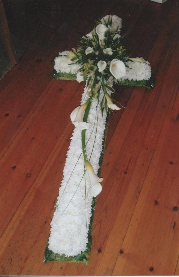 A based cross with crown of calla lilies textured