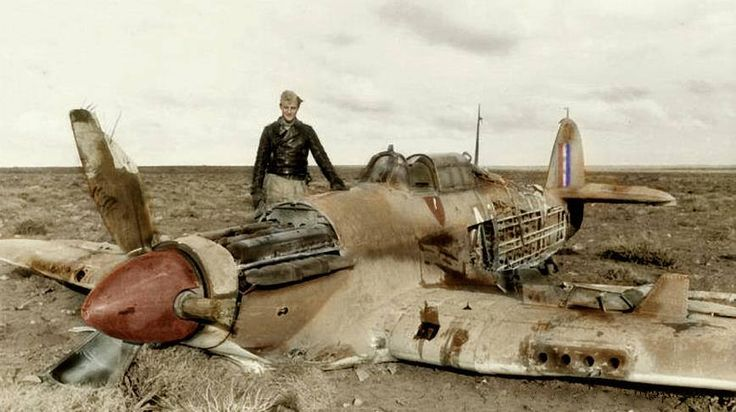 Luftwaffe pilot with the Hurricane he shot down, North Africa.
