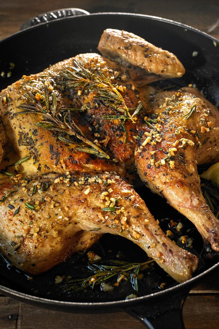 NYT Cooking: It isn't easy to cook chicken so that its skin is crisp and its interior juicy. Grilling, roasting and sauteing all have their problems. But there is an effective and easy method for getting it right, using two ovenproof skillets. A split chicken is placed in one of them, skin side down. The other skillet goes on top as a weight, which helps retain moisture and i...