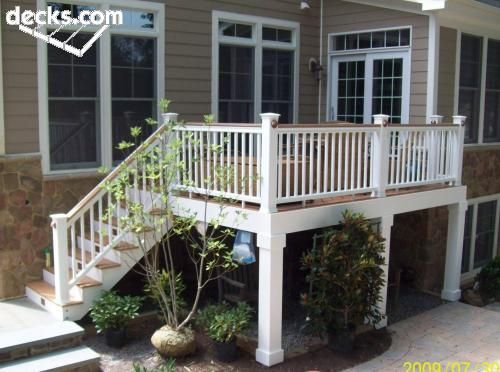 Love this simple deck design for our bilevel house... use the underneath of the deck ... white pillars!