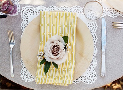 doily charger and bamboo paper plates -great for outdoor entertaining
