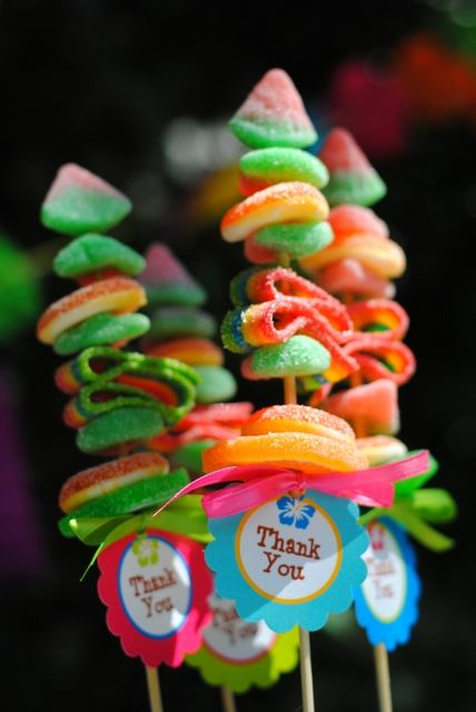 Candy skewer favors at a Luau Party #luau #party y don't people do soft toys on sticks for parties. ...looks awesome