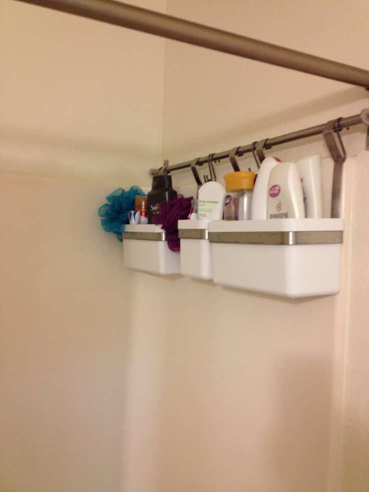Tubs hanging on a Ikea rod- so much better than the shower caddie that always falls!